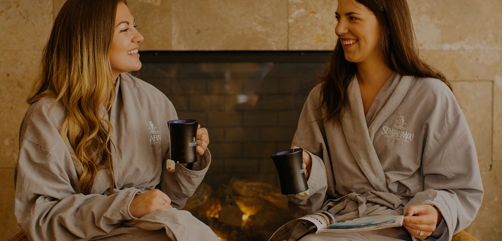 women in spa robes