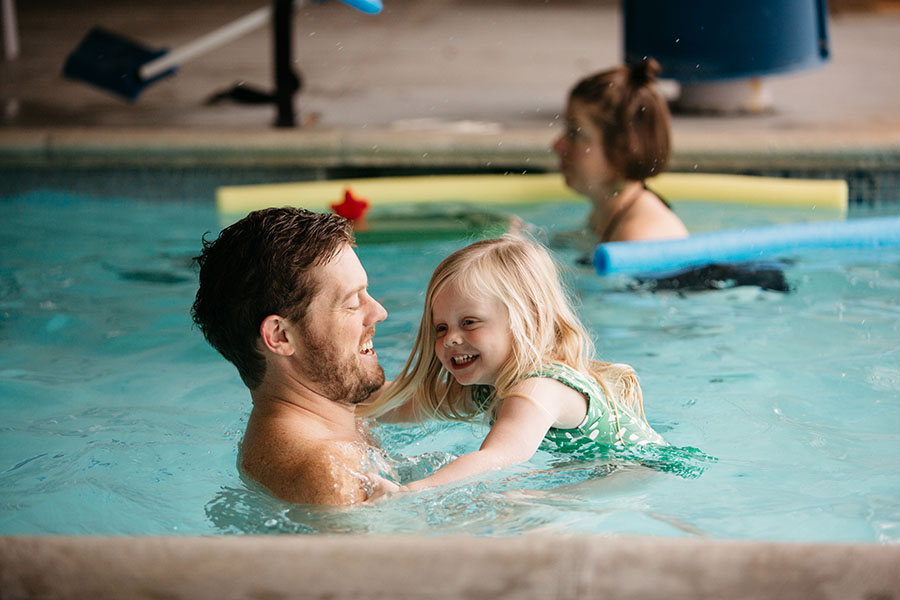 dad and child in pool